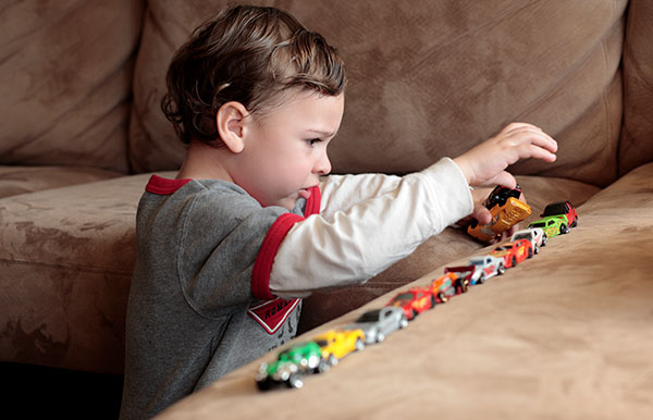 ABA Services boy play with trains.