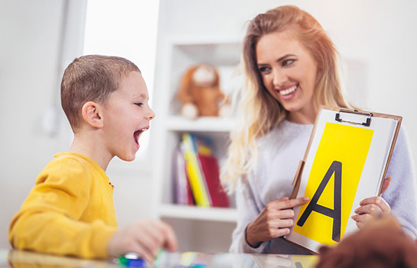A child learning communication skills through ABA Therapy.