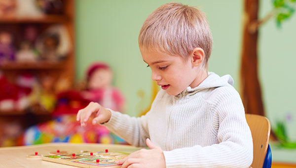 Kid playing with a puzzle